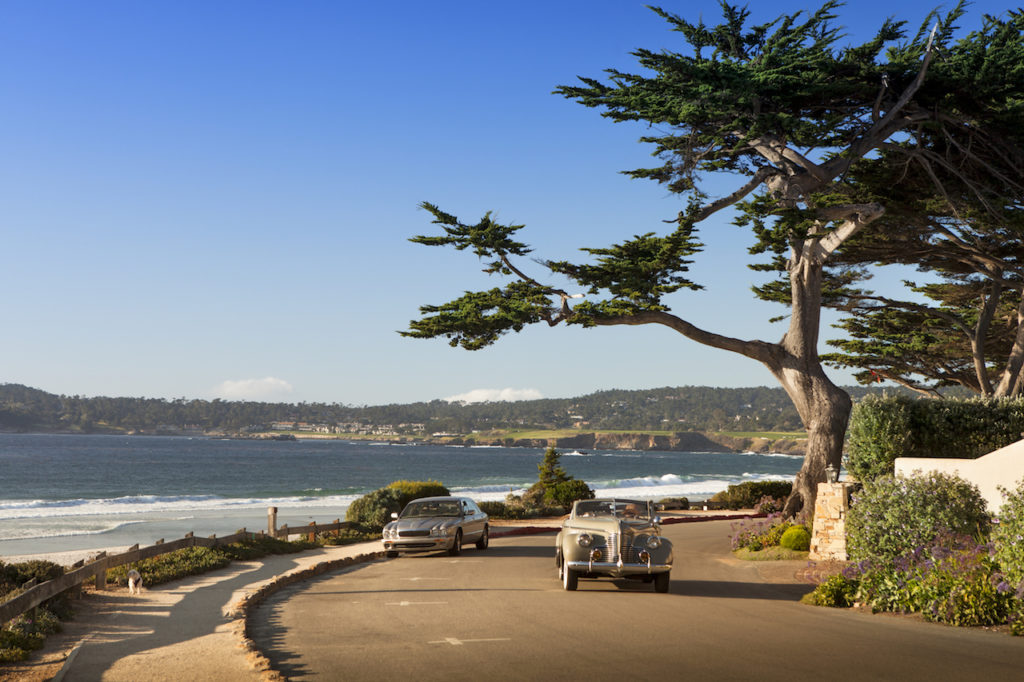 Vintage car on Scenic Drive with ocean in background - Carmel Point, CA - Living on the Monterey Peninsula