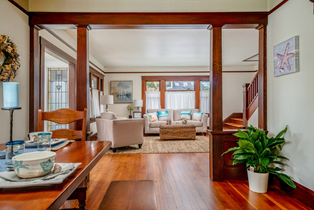 Interior living room of 1930s historic craftsman, with columns and bannister, Pacific Grove, CA